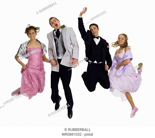 Portrait of two teenage couples jumping in mid-air