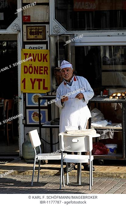 Chef in front of his diner, waiting for guests, sign chicken kebab 1 YTL, Karakoey, Istanbul, Turkey
