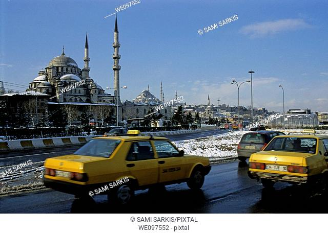Taxis driving past Suleymaniye Mosque, an Ottoman imperial mosque in Istanbul, Turkey