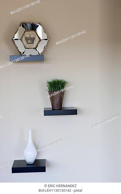 Centerpieces on shelves in bedroom
