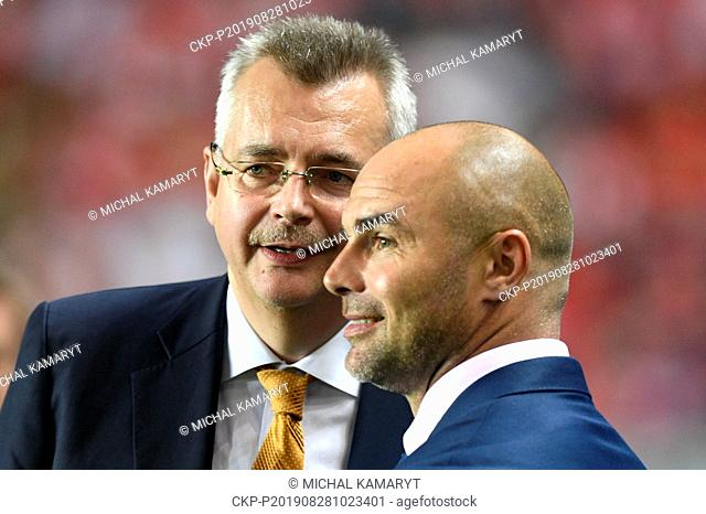 Chairman of the Board of SK Slavia Praha Jaroslav Tvrdik , left, speaks with Jan Nezmar, director of SK Slavia Praha prior to the Football Champions' League 4th...