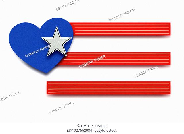Creative 4th of July concept photo of american flag with heart made of paper on white background