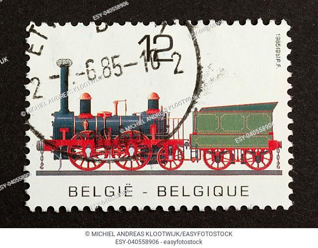 BELGIUM - CIRCA 1980: Stamp printed in Belgium shows an old train, circa 1980