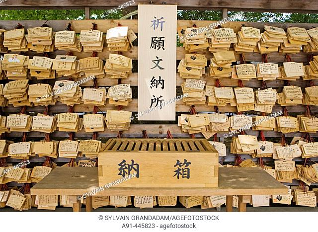 Wooden 'omikuji' (random fortunes at Shinto shrines and Buddhist temples in Japan) for sale in Meiji-Jingu Shinto shrine on Sunday, Tokyo. Japan