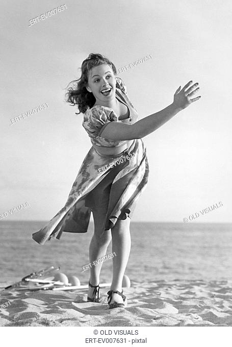 Woman playing on the beach