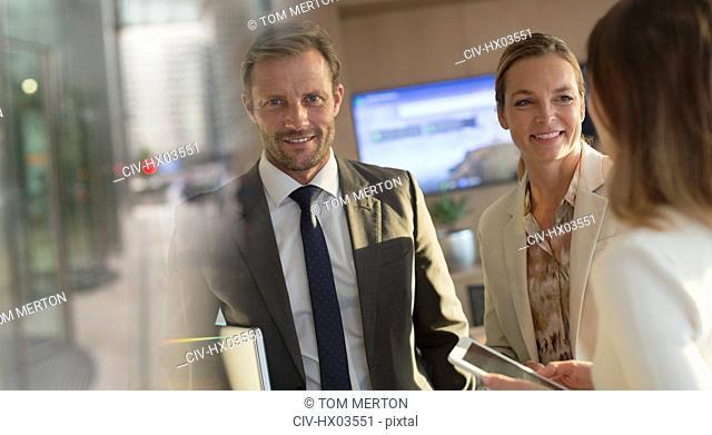 Portrait smiling businessman with businesswomen in office