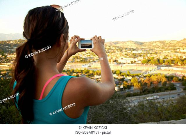 Woman photographing scenery