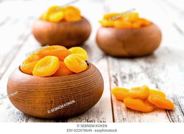 Dried Apricots in Wooden Bowl