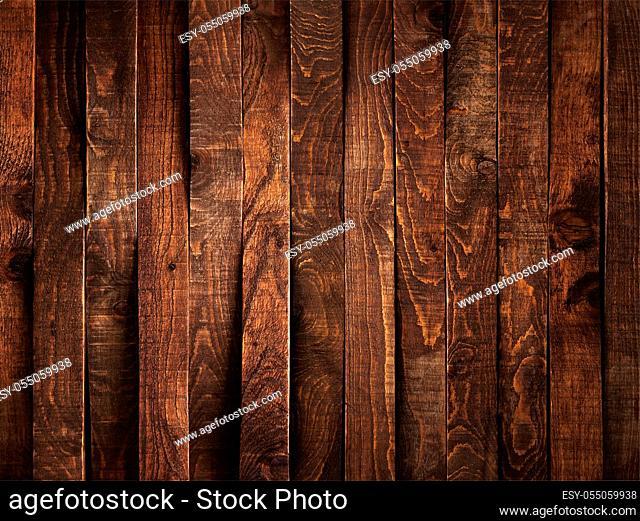 Dark brown wood background or texture of plank