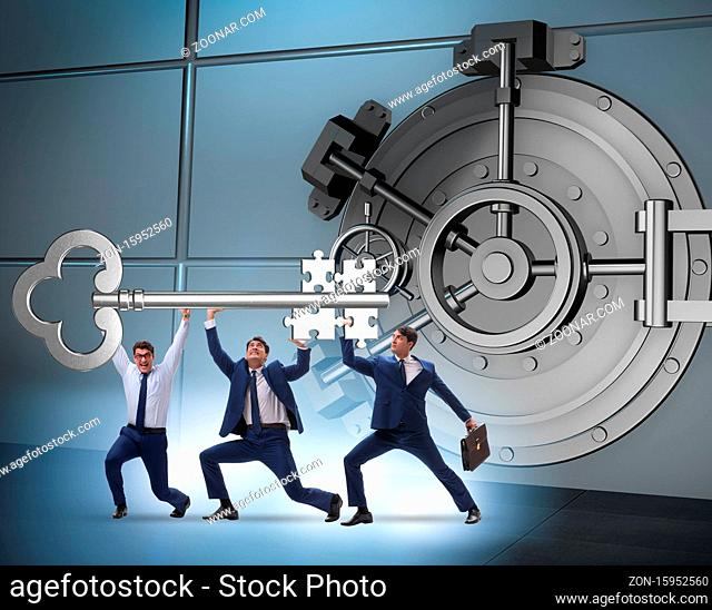 The businessman with key near bank vault door