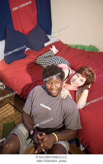 Portrait of a young inter-racial couple smiling