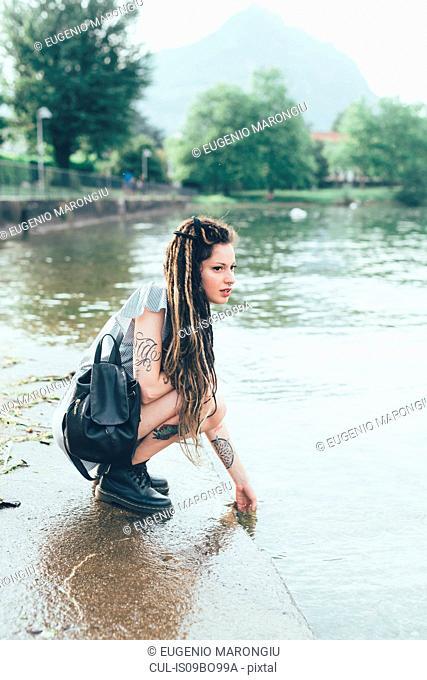 Woman by lakeside