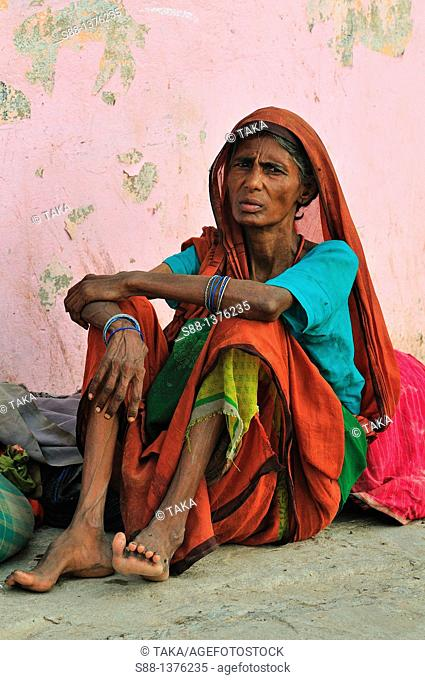 Woman sitting at the ghat by the Ganges River