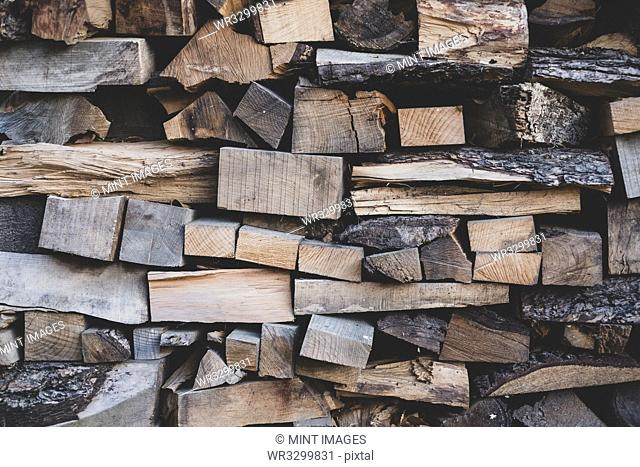 Close up of stack of wooden logs