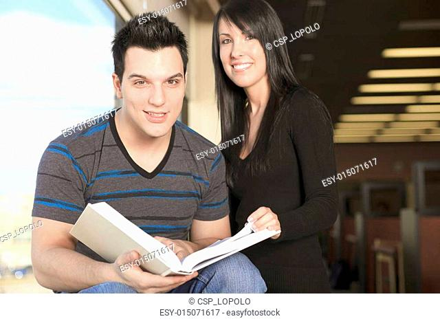 A 20 years old couple student studying