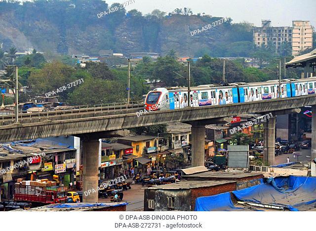 Metro train near Asalpha railway station, Mumbai, Maharashtra, India, Asia