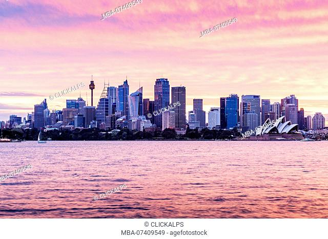 Sydney skyline and Opera House at sunset. New South Whales, Australia