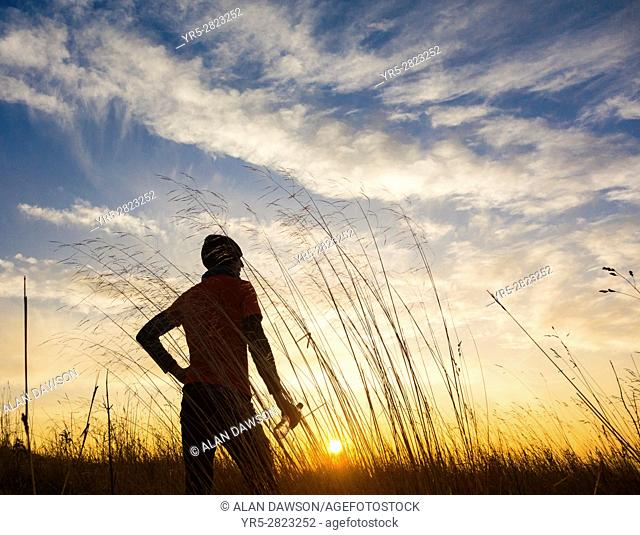Male jogger at sunrise on a frosty winter morning. Billingham, north east England. United Kingdom