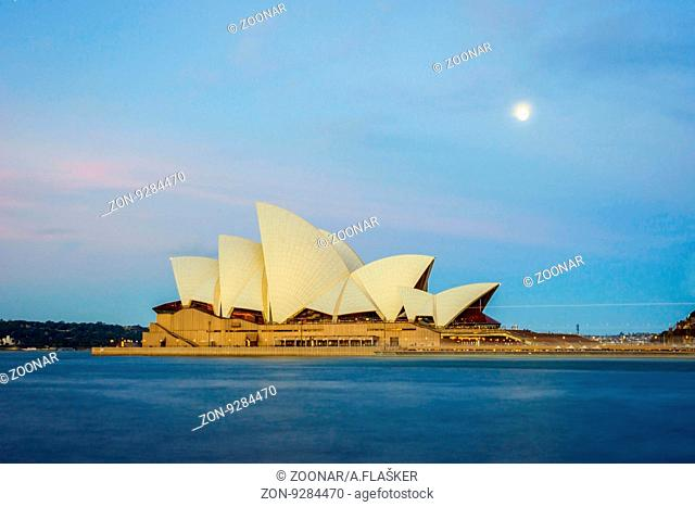 View on Sydney Opera house with moon at nigth, long exposure