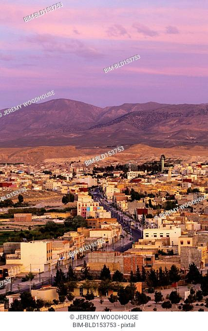 Aerial view of Midelt cityscape under sunset sky, Morocco