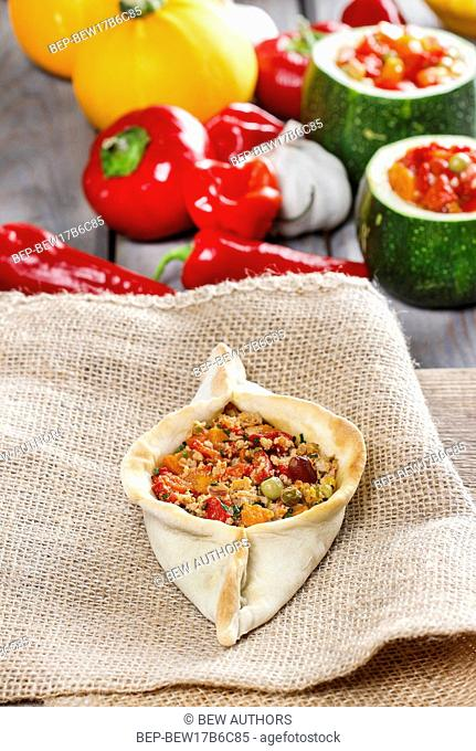 Pide, also known as Pita in some countries, is a dish similar to pizza, typically served as a part of Turkish, Armenian and Middle-Eastern cuisines