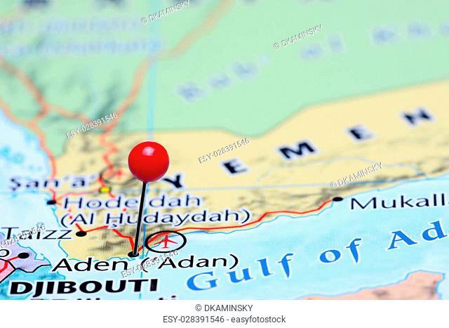 Photo of pinned Aden on a map of Asia. May be used as illustration for traveling theme