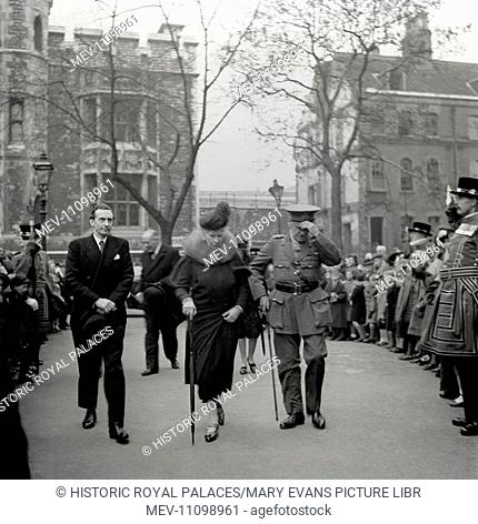 Queen Mary arrives at the Tower of London watched by crowds of visitors. She is escorted by Lord Chetwode (Constable) and Mr Mann (Master of the Armouries)