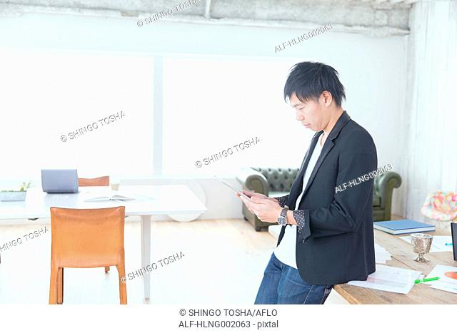 Japanese man working in modern office