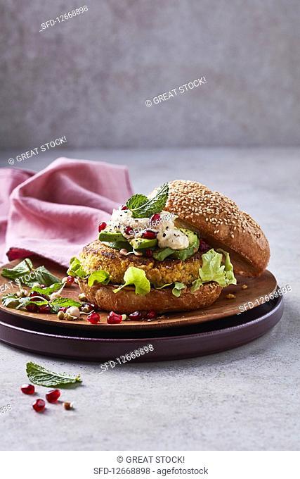 Vegan chickpea, corn and hummus burger