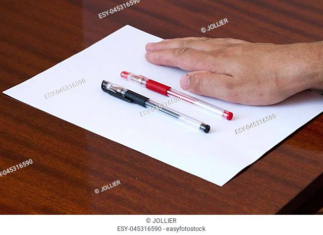 Close up of businessman's hand intending to write a document, petition or claim. A concept of drafting documentation process