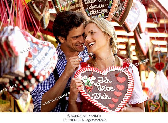 Man giving woman a chocolate heart