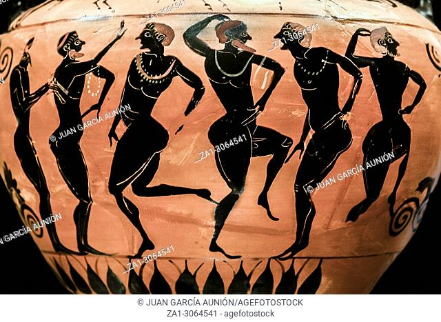Ancient greek terracotta neck-amphora with flute player and dancers. Isolated over black background. Metropolitan Museum