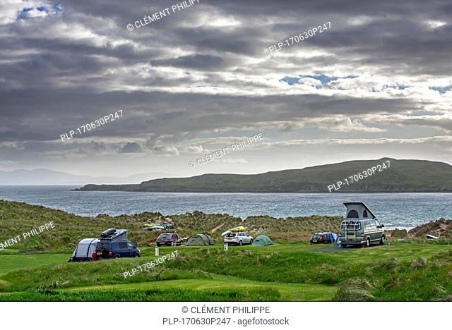 Campervans and tents on campsite along Loch Gairloch, Wester Ross, North-West Scottish Highlands, Scotland, UK