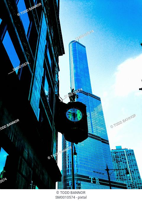 Trump International Hotel and Tower with Jewelers Building and clock in foreground. Chicago, Illinois
