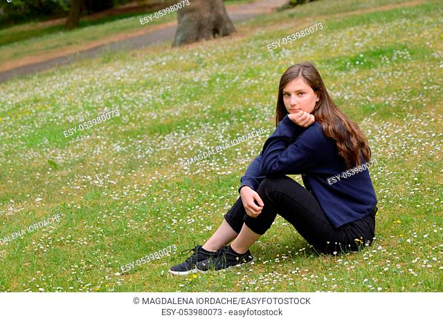 Portrait of a Pretty Teen Girl on summer field
