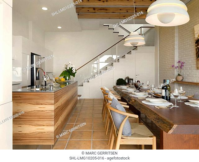 Large wooden dining table in kitchen
