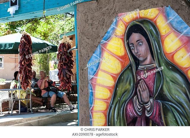 A Depiction Of The Virgin Of Guadalupe Adorns The Walls Of A Restaurant And Gallery, New Mexico, Usa