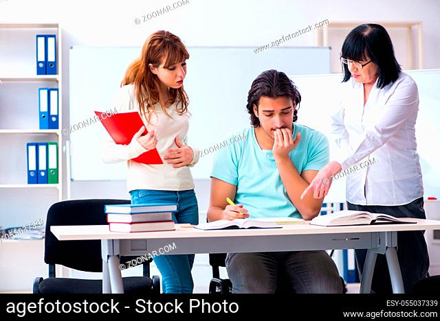 The old teacher and students in the classroom