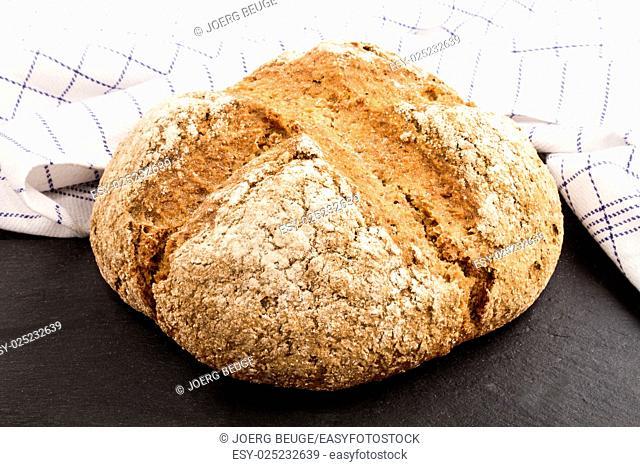 warm, freshly baked irish soda bread on slate