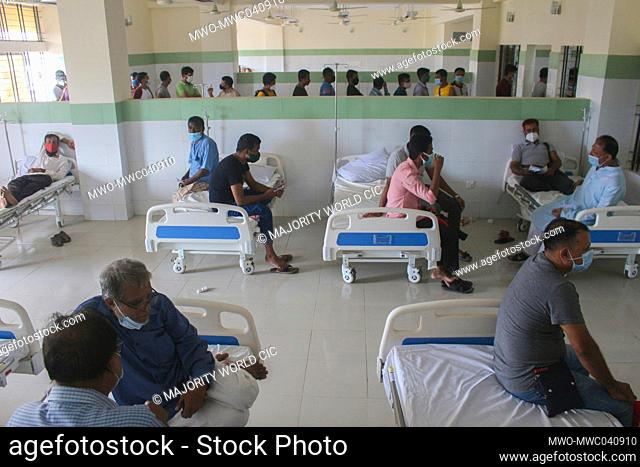 People are waiting in the observation room after getting the vaccination at the MAG Osmani Medical College and Hospital Vaccination Center