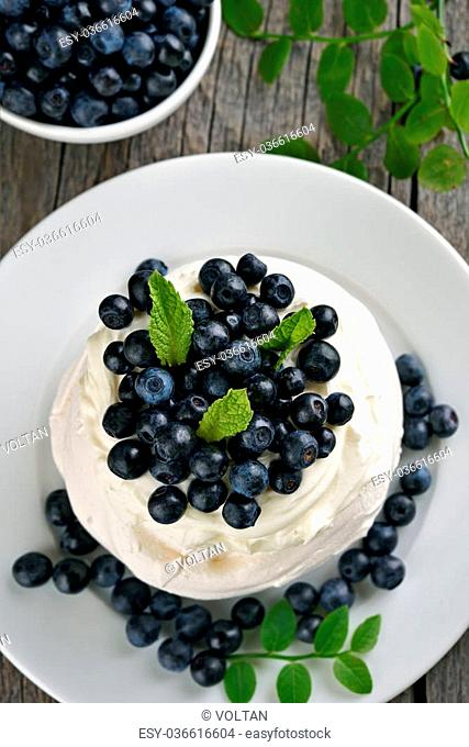 Meringue cake with fresh blueberries, top view
