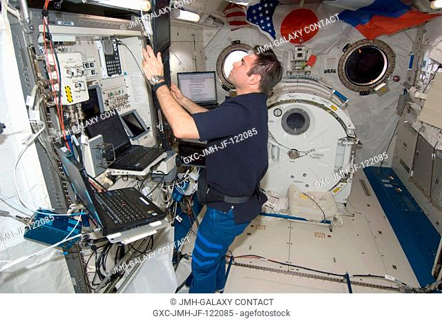 NASA astronaut Greg Chamitoff, Expedition 17 flight engineer, uses a computer near the Japanese Remote Manipulator System (JEM-RMS) work station in the Kibo...