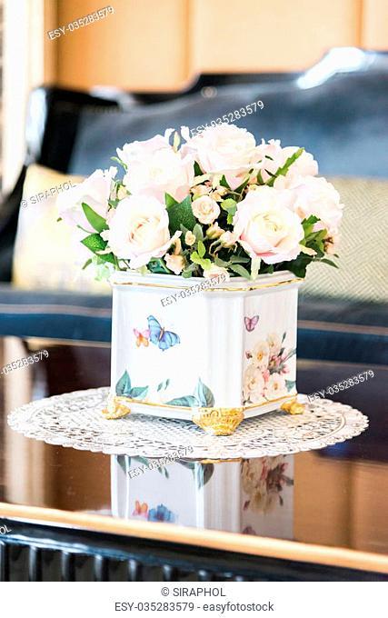 Beautiful fake plastic flower in vase decoration in living room