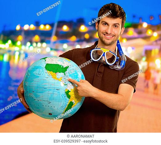Man With Snorkel Holding Globe, Outdoors