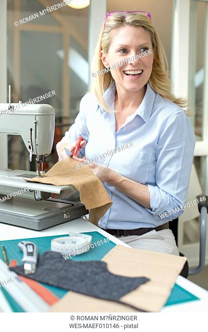 Smiling woman tailoring