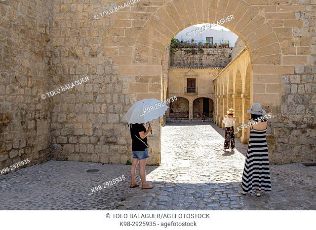 Chinese tourist taking pictures in the inner ward, portal de Las Taules, ibiza, Ibiza, Balearic Islands, Spain