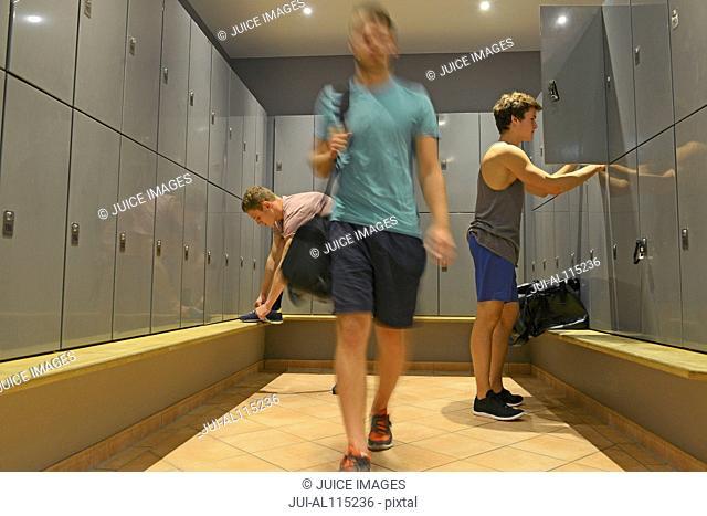 Teenage boys getting ready in gym locker room