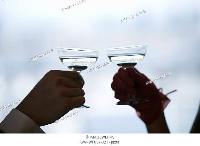 Young couple toasting wine, close-up