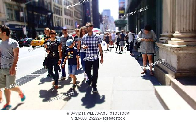 Pedestrians walking on the streets of New York, New York, distorted with an art filter and time-lapse imaging
