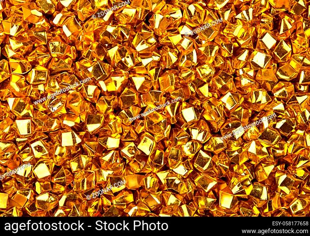Abstract background texture of colorful bright golden nuggets
